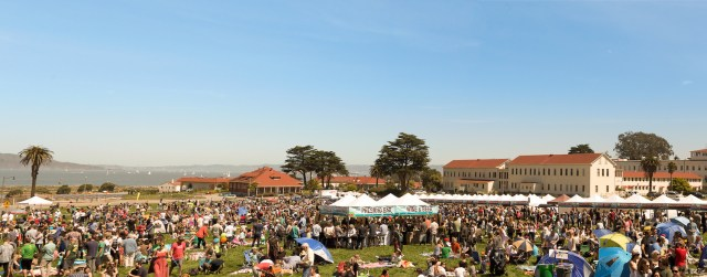 Presidio park filled with people standing and sitting and tents for Off the Grid: Presidio Picnic