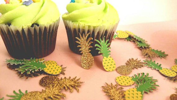 Pineapple Confetti on a table with two cupcakes