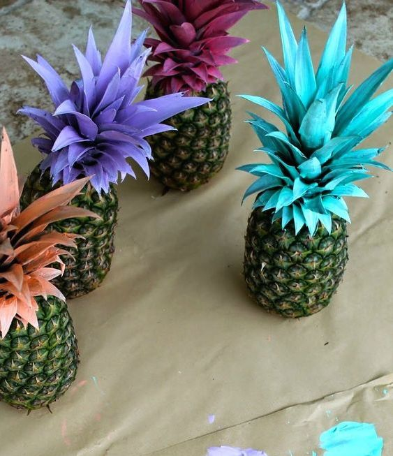 Pineapples with different color painted stems