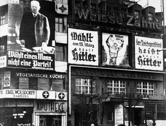 BERLIN: ELECTION, 1932.  Billboards in Potsdamer Platz, Berlin, for the German presidential candidates of 1932, Paul von Hindenburg and the future German Chancellor Adolf Hitler. Photographed in March 1932.