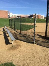 The home bench at Exeter's varsity softball field. (Photo: Ariane Cain)