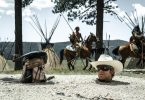 Tonto (Johnny Depp) and Lone Ranger (Armie Hammer) in a predicament