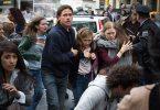 Brad Pitt is Gerry Lane, Abigail Hargrove is Rachel Lane, and Mireille Enos is Karin Lane in WORLD WAR Z