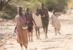 Keji Jale as Young Abital, Peterdeng Mongok as Young Mamere, Kon Akoue Auok as Young Daniel, Okwar Jale as Young Theo and David Madingi as Young Gabriel in this scene from The Good Lie