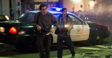 Louis (Jake Gyllenhaal) and Rick (Riz Ahmed) film a crime scene