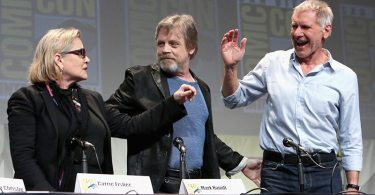 "SAN DIEGO, CA - JULY 10:  (L-R) Actors Carrie Fisher, Mark Hamill and Harrison Ford at the Hall H Panel for ""Star Wars: The Force Awakens"" during Comic-Con International 2015 at the San Diego Convention Center on July 10, 2015 in San Diego, California.  (Photo by Jesse Grant/Getty Images for Disney) *** Local Caption *** Carrie Fisher; Mark Hamill; Harrison Ford"