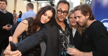 "COMIC-CON INTERNATIONAL: SAN DIEGO -- ""Universal Cable Productions Party"" -- Pictured: (L-R)  Emily Hampshire, Todd Stashwick, Barbara Sukowa, and Aaron Stanford -- (Photo by: Evans Vestal Ward/Syfy)"