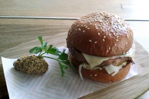 Brioche Corned Wagyu Beef, Sauerkraut, Swiss Cheese And Seeded Mustard In A Toasted Bun