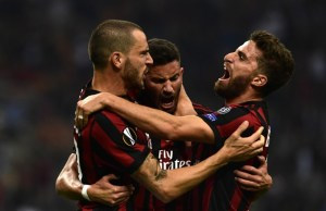 AC Milan's Argentinian defender Mateo Musacchio (R) celebrates with teammate Christian Bonucci (L) after scoring during the UEFA Europa League football match AC Milan vs HNK Rijeka at the San Siro stadium in Milan on September 28, 2017. / AFP PHOTO / MIGUEL MEDINA