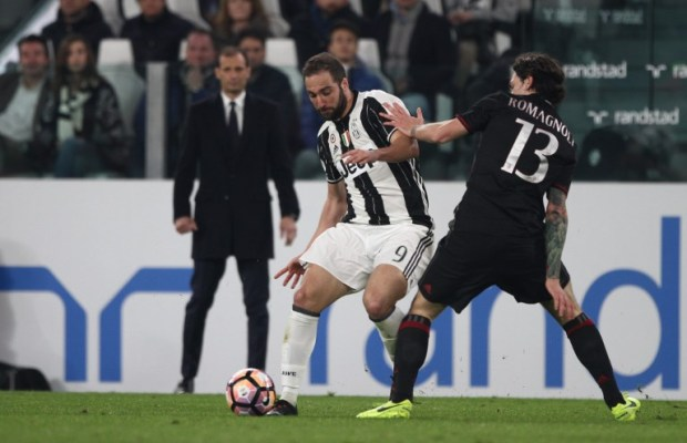 Juventus forward Gonzalo Higuain (9) fights for the ball against Milan defender Alessio Romagnoli (13) during the Serie A football match n.28 JUVENTUS - MILAN on 10/03/2017 at the Juventus Stadium in Turin, Italy. (Photo by Matteo Bottanelli/NurPhoto)