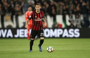 Milan midfielder Lucas Biglia (21) in action during the Serie A football match n.23 JUVENTUS - SASSUOLO on 31/03/2018 at the Allianz Stadium in Turin, Italy. Copyright 2018  Matteo Bottanelli
