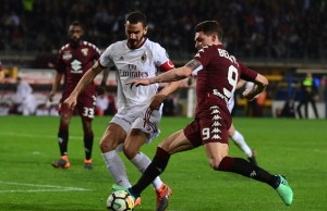 Torino's Italian forward Andrea Belotti vies with AC Milan's Captain Italian defender Leonardo Bonucci during the Italian Serie A football match Torino vs AC Milan at the Olimpic stadium in Torino on April 18, 2018.                       stadium in Milan on October 1, 2017. / AFP PHOTO / MIGUEL MEDINA