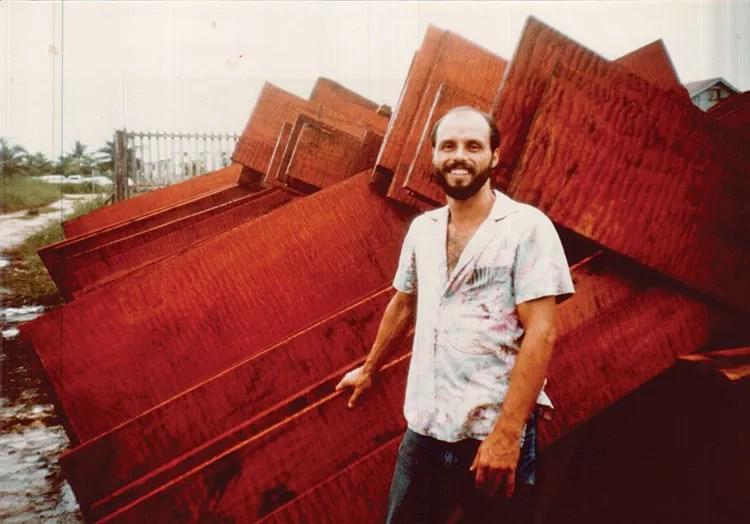 Robert Novak stands by his mahogany. (Photo courtesy of Novak)