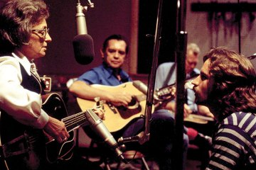 L—R : Mother Maybelle Carter, Merle Travis, Oswald Kirby,  and Jeff Hanna of the Nitty Gritty Dirt Band. Photo taken during the Will the Circle Be Unbroken sessions in August 1971 at Woodland Studios in Nashville. (photo by William E. McEuen)