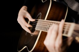 Playing-Acoustic-Guitar-Wallpaper