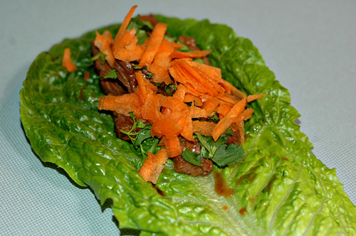 beef in lettuce leaf with carrots