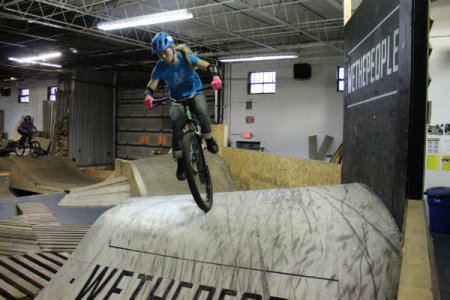 a girl rides one of the ramps at the wheel mill in homewood