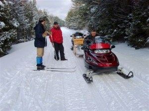 Snowmobilers and nordic skiiers alike enjoy Maine's many multi-use trails.