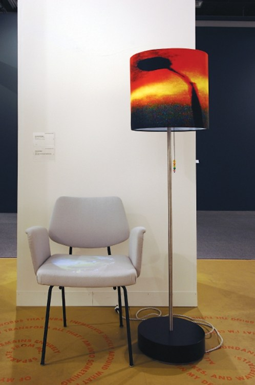 Lap Lamp, 2006, 1 DLP LED projector, 1 flashcard SD player. PHOTO COURTESY OF THE ARTIST AND LUHRING AUGUSTINE, NY.