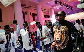 "A posh wedding in Lekki filled with guests from the music and film industries and complete with ""spraying""— throwing money in the air in the bride and groom's direction."