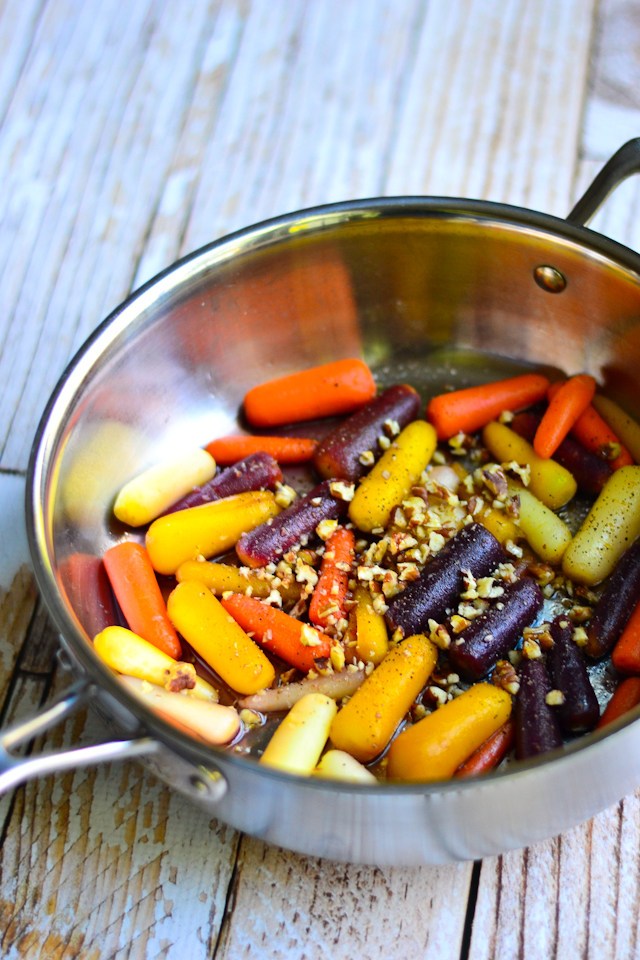 Sweet and tender glazed carrots topped with crunchy roasted pecans