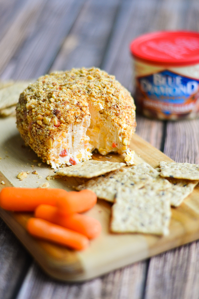 A creamy pimento cheese ball rolled in smoky roasted almonds! #sponsored #GameChangingSnacks