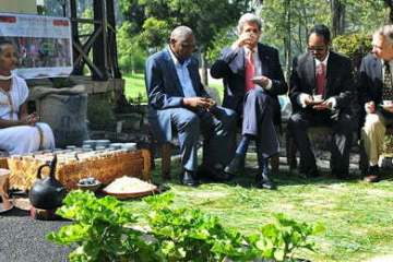 from Left Ethiopia Coffee Exporters Association & Green Coffee CEO Tadele Abraha, U.S. Secretary of State John Kerry, Ethiopia Commodity Exchange CEO Anteneh Assefa, and USAID Ethiopia Mission Director Dennis Weller participated in a traditional Ethiopian coffee ceremony at the U.S. Embassy in Addis Ababa on May 26