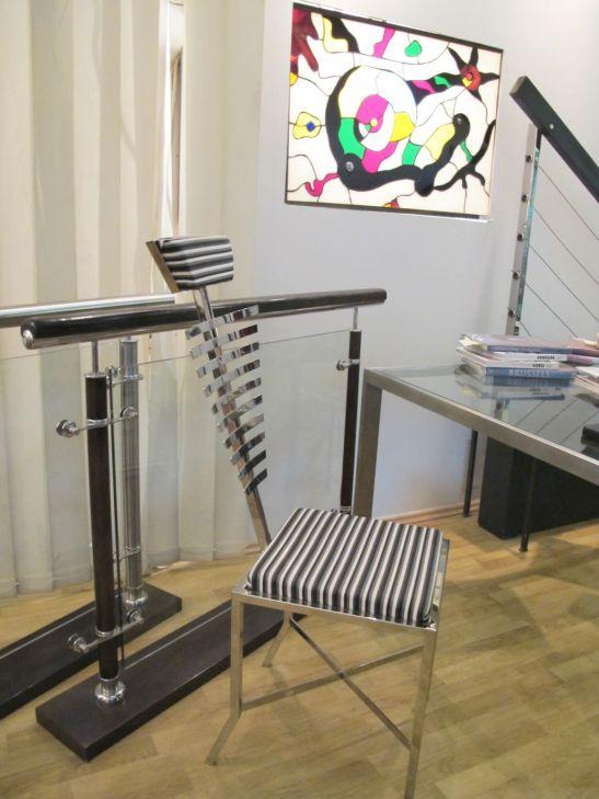 Model de balustrada cu sticla si scaun personalizat in birourile SuperFaber