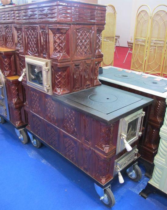 Model de soba perfecta pentru o casa de vacanta cu plita inglobata de la FANCRIS
