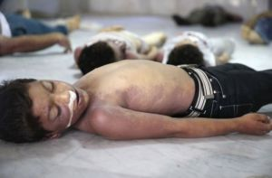 Photo shows bodies of children whom activists say were killed by gas attack in eastern suburbs of Damascus