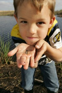 boy with small minnow n funny look