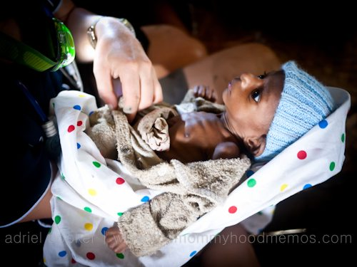 YWAM Medical volunteer holding Baby Umi. PNG, Western Province.