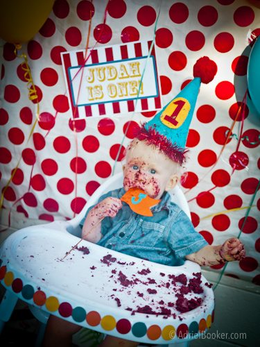 Judah's First Birthday Circus Party – circus tent smash cake and party hat.