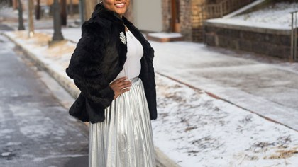 fur coat and metallic pleated skirt
