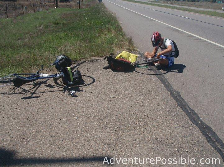Changing bike tube on the side of the road