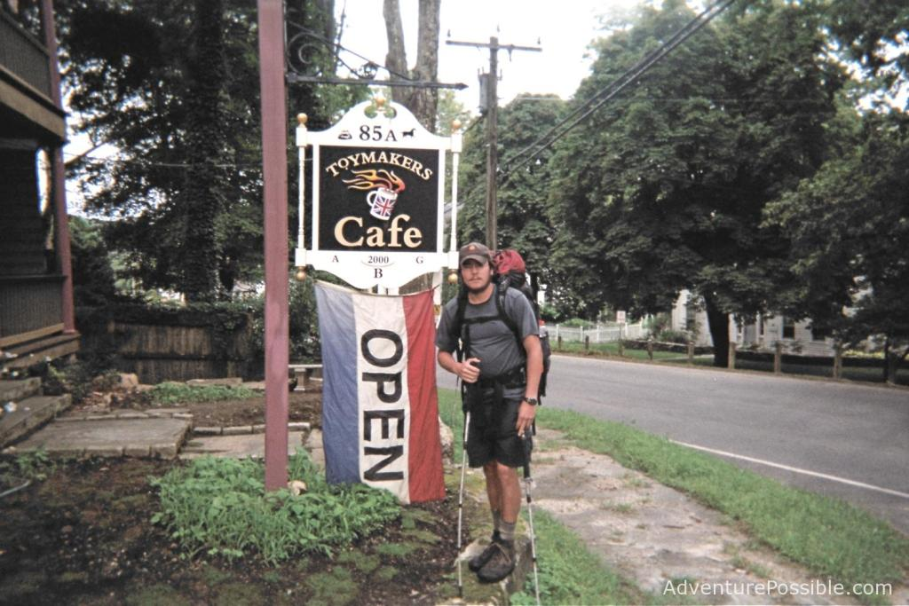 Backpacker at a cafe sign