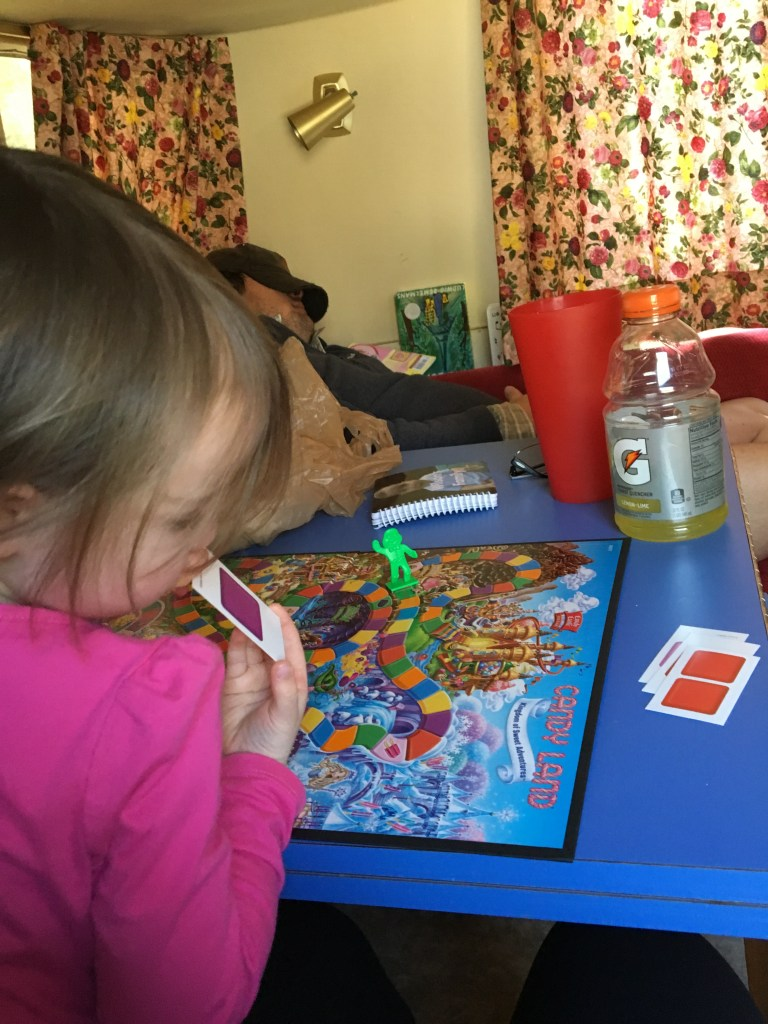 "Jane was introduced to and dominated both myself and Mark in Candy Land, which she adorably insists is called ""Candy Landy"". Sick dad crashed in the background."