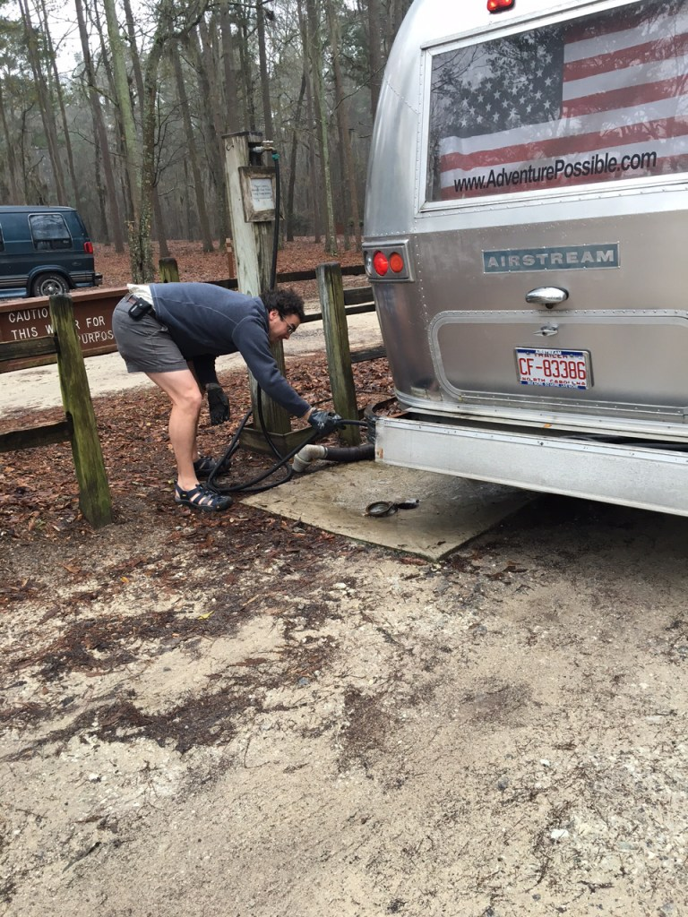 Dumping the waste water from toilet and sink in the RV.