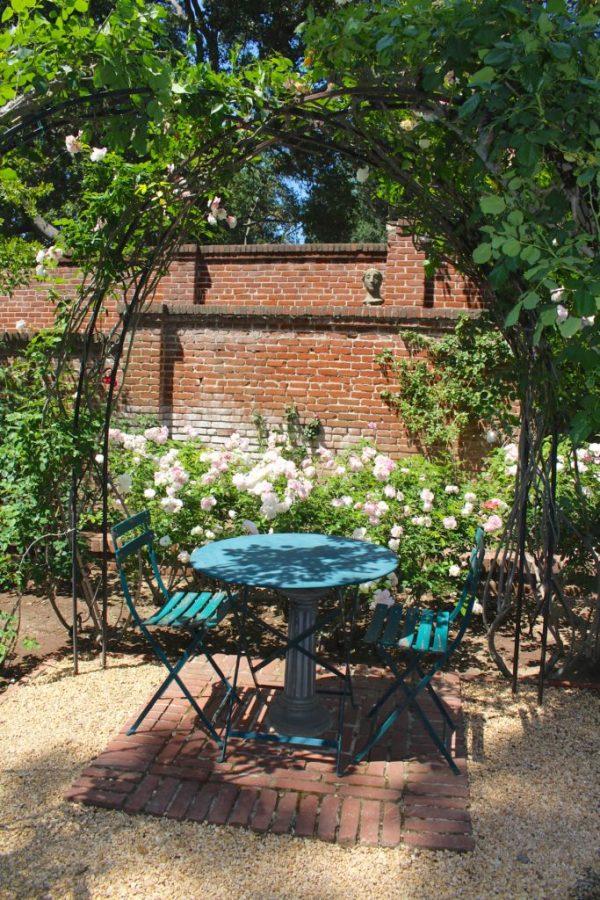 Cafe table in a rose garden