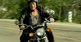 """Taiwan's TC Bank television commercial """"Dream Rangers"""": An old Taiwanese man wearing a leather jacket riding a motorcycle in Taiwan."""