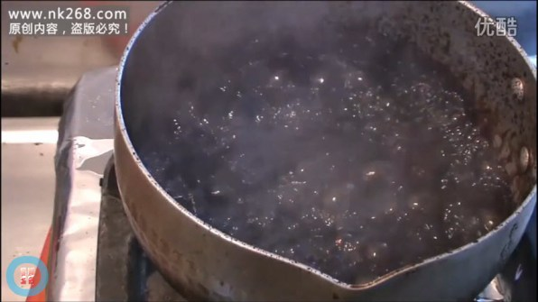 "The water and ""tar"" mixture being boiled."