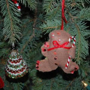 """The tree was a Grandma creation - the fabulous gingerbread man was made by my niece, years ago.  My five year old daughter said, """"This is kind of a weird ornament."""" I said, """"I love it.  Hang it up."""""""
