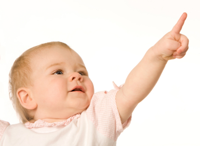 Little girl show a finger to upwards