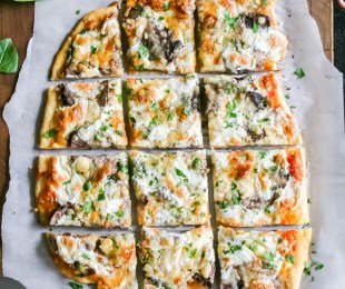 steak, shallot, and blue cheese flatbread. Simple dough rolled thin, topped with homemade crushed tomato sauce, then shallots, spinach, cheese blends, leftover filet, blue cheese, and mozzarella. Baked to perfection and served hot!   a flavor journal