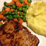 TV Dinner Peas and Carrots served with a Grilled Pork Chop and Yukon Gold Mashed Potatoes (Photo Credit: Adroit Ideals)