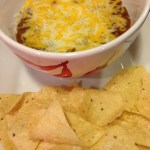 Cheesy hot and spicy black bean dip with tortilla chips!  (Photo Credit: Adroit Ideals)