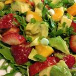 Strawberry, Mango and Avocado Salad over Arugula. Simple, tropical, and tasty. (Photo Credit: Adroit Ideals)