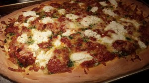 Roasted Tomato, Ricotta, Mozzarella, Garlic and Pesto Pizza -- Hot from the oven! (Photo Credit: Adroit Ideals)