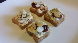 Simple Amuse Bouche: Laughing Cow Cheese, Fig Jam, Toasted Sliced Almonds on Mini-Toasts (Photo Credit: Adroit Ideals)