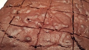 Slice the brownies into equal squares (Photo Credit: Adroit Ideals)